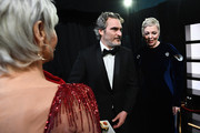 In this handout photo provided by A.M.P.A.S. Jane Fonda, Best Actor award winner Joaquin Phoenix, and Olivia Colman stand backstage during the 92nd Annual Academy Awards at the Dolby Theatre on February 09, 2020 in Hollywood, California.