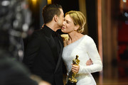 In this handout photo provided by A.M.P.A.S. Rami Malek and Best Actress award winner Renée Zellweger embrace backstage during the 92nd Annual Academy Awards at the Dolby Theatre on February 09, 2020 in Hollywood, California.