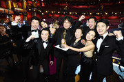 "In this handout photo provided by A.M.P.A.S. Best Picture Award winners for ""Parasite"" pose onstage during the 92nd Annual Academy Awards at the Dolby Theatre on February 09, 2020 in Hollywood, California."