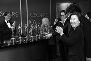 "Image has been converted to black and white.) Screenwriter Han Jin-won, director Bong Joon-ho and producer Kwak Sin-ae, winners of the Original Screenplay, International Feature Film, Directing, and Best Picture awards for ""Parasite,"" attend the 92nd Annual Academy Awards Governors Ball at Hollywood and Highland on February 09, 2020 in Hollywood, California."