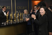 "Screenwriter Han Jin-won, director Bong Joon-ho and producer Kwak Sin-ae, winners of the Original Screenplay, International Feature Film, Directing, and Best Picture awards for ""Parasite,"" attend the 92nd Annual Academy Awards Governors Ball at Hollywood and Highland on February 09, 2020 in Hollywood, California."