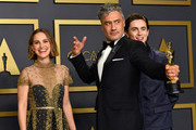 "Natalie Portman (L), Timothée Chalamet (R) with Director Taika Waititi, winner of the Adapted Screenplay award for ""Jojo Rabbit,"" pose in the press room during the 92nd Annual Academy Awards at Hollywood and Highland on February 09, 2020 in Hollywood, California."