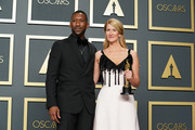 """(L-R) Mahershala Ali and Laura Dern, winner of Best Actress in a Supporting Role for """"Marriage Story"""", poses in the press room during 92nd Annual Academy Awards at Hollywood and Highland on February 09, 2020 in Hollywood, California."""