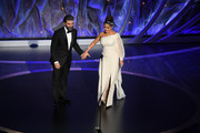 (L-R) Oscar Isaac and Salma Hayek Pinault walk onstage during the 92nd Annual Academy Awards at Dolby Theatre on February 09, 2020 in Hollywood, California.