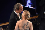 (L-R) Composer Alexandre Desplat and Scarlett Johansson attend the 92nd Annual Academy Awards at Dolby Theatre on February 09, 2020 in Hollywood, California.