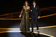 (L-R) Natalie Portman and Timothée Chalamet walk onstage during the 92nd Annual Academy Awards at Dolby Theatre on February 09, 2020 in Hollywood, California.