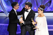 (L-R) Stuart Wilson accepts the Best Sound Mixing award for '1917' from Oscar Isaac and Salma Hayek Pinault onstage during the 92nd Annual Academy Awards at Dolby Theatre on February 09, 2020 in Hollywood, California.