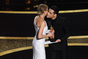(L-R) Rami Malek and Renée Zellweger, winner of the Actress in a Leading Role award for 'Judy,' walk onstage during the 92nd Annual Academy Awards at Dolby Theatre on February 09, 2020 in Hollywood, California.