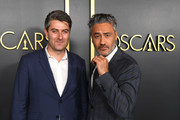 (L-R) Carthew Neal and Taika Waititi attend the 92nd Oscars Nominees Luncheon on January 27, 2020 in Hollywood, California.