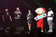 (L-R) Jaime Ferreira, Intern John, Rose and EJ of 93.3 FLZ speak with Stewie from Family Guy onstage during 93.3 FLZ's Jingle Ball 2019 Presented by Capital One at Amalie Arena on December 01, 2019 in Tampa, Florida.