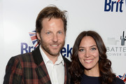 Actors Jamie Bamber (L) and Kerry Norton arrive at the 9th Annual BritWeek launch party at the British Consul General's Residence on April 21, 2015 in Los Angeles, California.