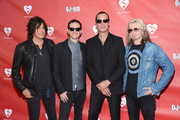 Dean DeLeo, Chester Bennington, Robert DeLeo and Eric Kretz of Stone Temple Pilots attend the 9th Annual MusiCares MAP Fund Benefit Concert at Club Nokia on May 30, 2013 in Los Angeles, California.