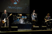 (L-R) Musicians Robert DeLeo, Eric Kretz, Chester Bennington and Dean DeLeo perform as Stone Temple Pilots at the 9th Annual MusiCares MAP Fund Benefit Concert at Club Nokia on May 30, 2013 in Los Angeles, California.