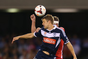 Harry Kewell of the Heart and Adrian Leijer of the Victory contest for the ball during the round one A-League match between the Melbourne Victory and the Melbourne Heart at Etihad Stadium on October 12, 2013 in Melbourne, Australia.