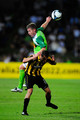 Vince Lia of the Phoenix contests the ball with Ufuk Talay of the Fury during the round 11 A-league match between the North Queensland Fury and the Wellington Phoenix at Dairy Farmers Stadium on October 17, 2009 in Townsville, Australia.