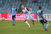 Joseph Mills of the Glory is challenged by  Luke Wilkshire of Sydney during the round 13 A-League match between Sydney FC and Perth Glory at Allianz Stadium on December 30, 2017 in Sydney, Australia.