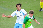 Ufuk Talay of the Fury and Nick Carle of Sydney FC contest the ball during the round two A-League match between the North Queensland Fury and Sydney FC at Dairy Farmers Stadium on August 14, 2010 in Townsville, Australia.