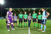 Andy Keogh of the Glory and Alex Wilkinson of Sydney attend the coin toss during the round 25 A-League match between the Perth Glory and Sydney FC at nib Stadium on March 29, 2018 in Perth, Australia.