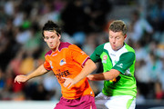 Robbie Kruse of the Roar is tackled by Ufuk Talay of the Fury  during the round five A-League match between the North Queensland Fury and the Brisbane Roar at Dairy Farmers Stadium on September 5, 2009 in Townsville, Australia.