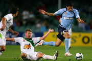 Simon Colosimo of Sydney FC gets past Ufuk Talay of the Fury during the round six A-League match between Sydney FC and the North Queensland Fury at the Sydney Football Stadium on September 12, 2009 in Sydney, Australia.
