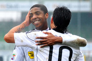 Luis Jimenez of Cesena celebrates with Dominique Sossorobla Malonga of Cesena after scoring a goal from penalty kick during the Serie A match between AC Cesena and AC Chievo Verona at Dino Manuzzi Stadium on February 27, 2011 in Cesena, Italy.