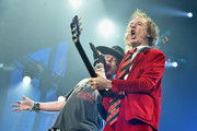 Singer Axl Rose (L) and guitarist Angus Young of AC/DC perform during the AC/DC Rock Or Bust Tour at Madison Square Garden on September 14, 2016 in New York City.
