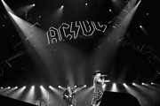 This image was converted to black and white using digital filters) Singer Axl Rose (L) and guitarist Angus Young of AC/DC perform during the AC/DC Rock Or Bust Tour at Madison Square Garden on September 14, 2016 in New York City.