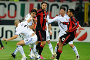 Zlatan Ibrahimovic and Ronaldinho of AC Milan battle for the ball against Pepe, Sami Khedira and Sergio Ramos of Real Madrid  during the Uefa Champions League group G match between AC Milan and Real Madrid at Stadio Giuseppe Meazza on November 3, 2010 in Milan, Italy.