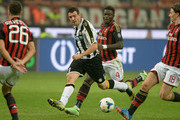 Andrea Lazzari of Udinese Calcio (C) in action during the Serie A match between AC Milan and Udinese Calcio at Giuseppe Meazza Stadium on October 19, 2013 in Milan, Italy.