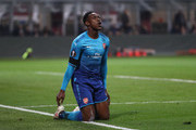 Danny Welbeck of Arsenal reacts after team-mate Aaron Ramsey scores during the UEFA Europa League Round of 16 match between AC Milan and Arsenal at the San Siro on March 8, 2018 in Milan, Italy.