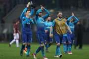 Aaron Ramsey of Arsenal and team-mates acknowledge the fans after the UEFA Europa League Round of 16 match between AC Milan and Arsenal at the San Siro on March 8, 2018 in Milan, Italy.