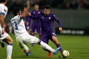 Giuseppe Rossi of ACF Fiorentina battles for the ball with Joao Pinto of OS Belenenses during the UEFA Europa League match between ACF Fiorentina and Os Belenenses on December 10, 2015 in Florence, Italy.