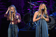 Nelly Joy (L) and Colbie Caillat of the band Gone West perform onstage at ACM Lifting Lives Presents: Borderline Strong Concert at Thousand Oaks Civic Arts Plaza on February 11, 2019 in Thousand Oaks, California.