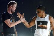 Musician Brian Kelley (L) of Florida Georgia Line and rapper Nelly perform onstage during Tim McGraw's Superstar Summer Night presented by the Academy of Country Music at the MGM Grand Garden Arena on April 8, 2013 in Las Vegas, Nevada.