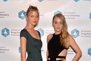 Models Martha Hunt and Elizabeth Gilpin attend Alzheimer's Drug Discovery Foundation eighth Annual Connoisseur's Dinner at Sotheby's on May 1, 2014 in New York City.