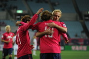 Diego Forlan #10 of Cerezo Osaka celebrates the fourth goal with Mitch Nichols during the AFC Champions League match between Cerezo Osaka and Buriram United at Nagai Stadium on March 18, 2014 in Osaka, Japan.