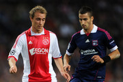 Christian Eriksen (L) of Ajax duels for the ball with Maxime Gonalons of Olympique Lyonnais during the UEFA Champions League group D match between AFC Ajax and Olympique Lyonnais at the Amsterdam Arena on September 14, 2011 in Amsterdam, Netherlands.