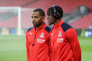Jason Puncheon of Crystal Palace and Wilfried Zaha of Crystal Palace look around the pitch ahead of the Premier League match between AFC Bournemouth and Crystal Palace at Vitality Stadium on October 1, 2018 in Bournemouth, United Kingdom.