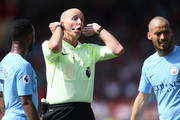 Referee Mike Dean in action during the Premier League match between AFC Bournemouth and Manchester City at Vitality Stadium on August 26, 2017 in Bournemouth, England.