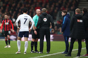 Referee Mike Dean speaks to the fourth offical Graham Scott during the Premier League match between AFC Bournemouth and Tottenham Hotspur at Vitality Stadium on March 11, 2018 in Bournemouth, England.
