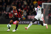 Callum Wilson of AFC Bournemouth controls the ball as Mamadou Sakho of Crystal Palace looks on during the Premier League match between AFC Bournemouth and Crystal Palace at Vitality Stadium on October 1, 2018 in Bournemouth, United Kingdom.