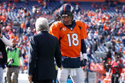 New England Patriots owner Robert Kraft speaks to  Peyton Manning #18 of the Denver Broncos on the field during warm ups before the AFC Championship game at Sports Authority Field at Mile High on January 24, 2016 in Denver, Colorado.