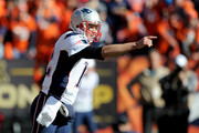 Tom Brady #12 of the New England Patriots gestures in the first quarter against the Denver Broncos in the AFC Championship game at Sports Authority Field at Mile High on January 24, 2016 in Denver, Colorado.