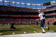 Tom Brady #12 of the New England Patriots runs on to the field prior to the AFC Championship game against the Denver Broncos at Sports Authority Field at Mile High on January 24, 2016 in Denver, Colorado.