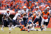 Tom Brady #12 of the New England Patriots runs for an 11-yard scramble in the second quarter against the Denver Broncos  in the AFC Championship game at Sports Authority Field at Mile High on January 24, 2016 in Denver, Colorado.
