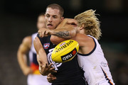 Rory Sloane of the Crows tackles Heath Scotland of the Blues during the round three AFL NAB Challenge match between the Carlton Blues and the Adelaide Crows at Etihad Stadium on February 24, 2014 in Melbourne, Australia.