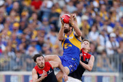 Josh Kennedy of the Eagles attempts a spectacular mark over Michael Hibberd of the Demons (left) and Sam Frost of the Demons during the 2018 AFL Second Preliminary Final match between the West Coast Eagles and the Melbourne Demons at Optus Stadium on September 22, 2018 in Perth, Australia.