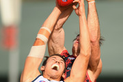 Tom Doedee of the Crows marks infront of Tim Smith of the Demons  during the round 10 AFL match between the Melbourne Demons and the Adelaide Crows at Traeger Park on May 27, 2018 in Alice Springs, Australia.