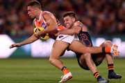 Josh Kelly of the Giants  is tackled by Bryce Gibbs of the Crows during the 2018 AFL round 11 match between the Adelaide Crows and the GWS Giants at the Adelaide Oval on June 03, 2018 in Adelaide, Australia.