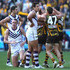 Sam Mitchell Photos - Dockers players look dejected as Sam Mitchell, Luke Breust and Shaun Burgoyne of the Hawks celebrate a goal during the round 11 AFL match between the Hawthorn Hawks and the Fremantle Dockers at Melbourne Cricket Ground on June 5, 2011 in Melbourne, Australia. - AFL Rd 11 - Hawthorn v Fremantle